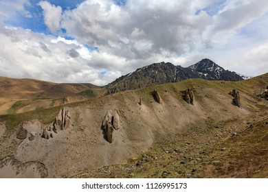 Mountain landscape. The region of Elbrus, Karachay-Cherkessia, Russia. The gorge of the Malka River, the Gyly-Su tract. The place of exit of curative mineral springs and volcanic rocks.