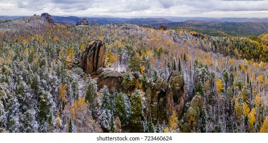 Mountain landscape in the reserve Stolby, Russia, Siberia, Krasnoyarsk, fall, the first snow. Shooting from air. soft focus