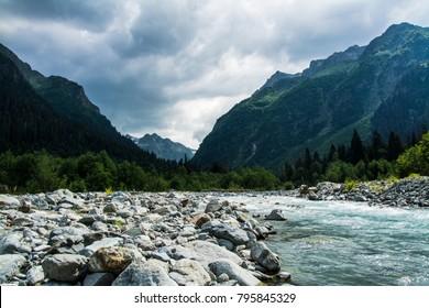 Mountain landscape. The mountain river.