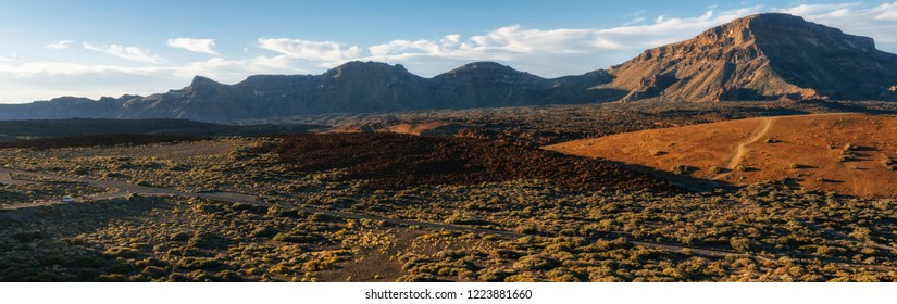 Mountain landscape with road, volcanic lava rocks and desert with Mounts Guajara, Pasajiron and Majua, Teide National Park, Tenerife, Canary Islands
