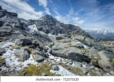 mountain landscape with rocks and snow in the foreground