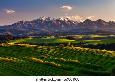 Mountain landscape shot with fields in the foreground