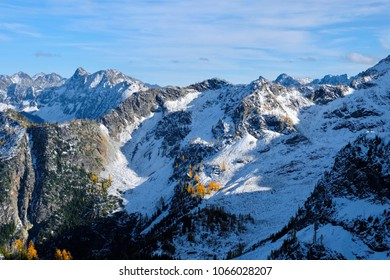 Mountain landscape with snow and yellow trees. Cascade Mountains. North Cascades National Park. Seattle. Winthrop. Washington. United States.