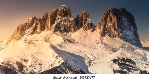 Mountain landscape and spine covered with snow Marmolada, Dolomites during sunset, Italy