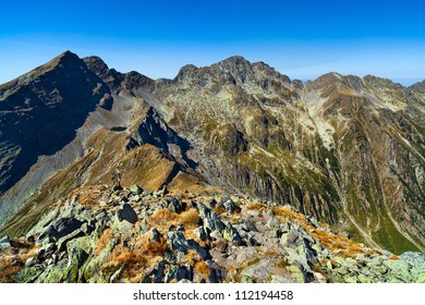 Mountain landscape in a sunny summer day with blue sky above