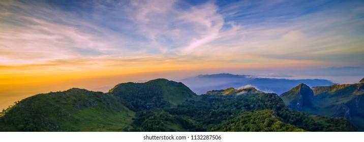 mountain landscape with sunrise and mist