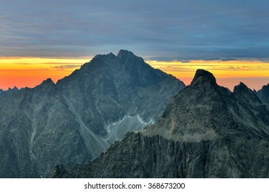 Mountain landscape at sunset. View of the Rysy on Gerlach Peak (Gerlachovsky Stit) and Ganek Peak in High Tatra Mountains, Slovakia.