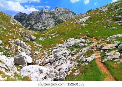 Mountain landscape with trail leading towards summit