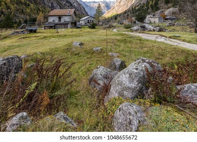 a mountain landscape in Val di Mello in an autumnal sunny day