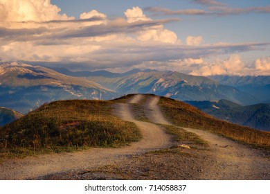 Mountain landscape view with curvy road and colorful sunset clouds, Svaneti, Country of Georgia