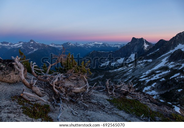 Mountain Landscape view during a beautiful sunset. Picture taken from top of Webb Peak near Chilliwack, East of Greater Vancouver, British Columbia, Canada.