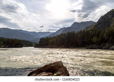 Mountain landscape with a view of the river flooded with sunlight