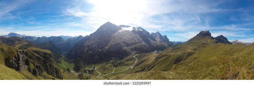 Mountain landscape. View of the winding, mountain road and the highest mountain in the Dolomites - Marmolada.
