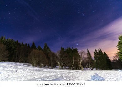 Mountain landscape at winter and beautifull starry sky