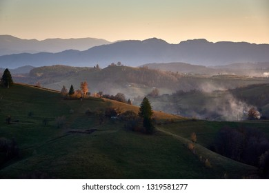 Mountain landscape with winter morning fog at sunrise