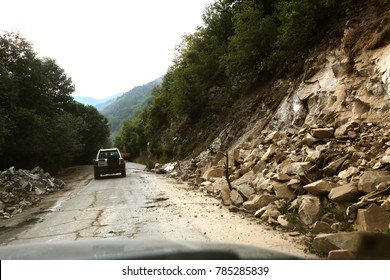 Mountain landslide stone slopes threaten to block roads and forest roads. The danger for drivers and residents of the city at the foot of dangerous rocky mountains