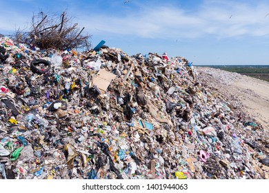 Mountain large garbage pile and pollution,Pile of stink and toxic residue,These garbage come from urban and industrial areas can not get rid of, Consumer society Cause massive waste