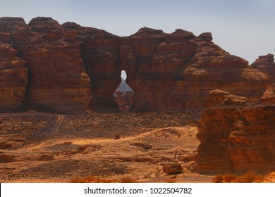 A mountain made of solidified ancient lava  that has a hole that resembles a bowling pin at the Elephant Mountain site in Al Ula, Saudi Arabia