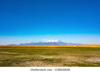 Mountain and Marshes, Reeds under the clean blue sky. This is Erciyes Mountain in Kayseri Turkey. Sultan Sazligi national park in Develi Valley. Beautiful pastoral landscape