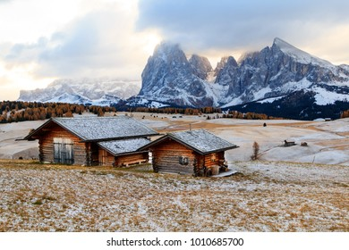 Mountain meadow and wooden house Alpe di Siusi or Seiser Alm the Langkofel mountain range with Bolzano province, South Tyrol in Dolomites at Italy