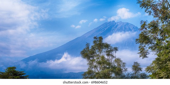 Mountain Meru in Tanzania, Africa with the cloudy and blue sky. View from Arusha city.