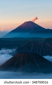 Mountain in mist, fog, sulfur and smoking Volcano Bromo in Indonesia
