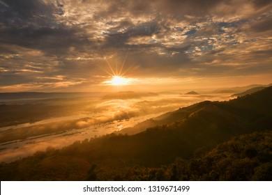 Mountain Mist in sunrise,mist on sunrise,mist over mountain during sunrise
