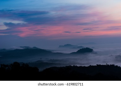 Mountain Mist,Beautiful landscape in the mountains at sunrise,Thailand