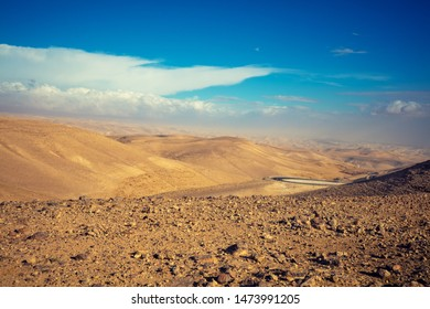 Mountain nature landscape. View of valley from mount. Desert in early morning. Judaean Desert. Landscape in Dead sea region. Nature Israel.