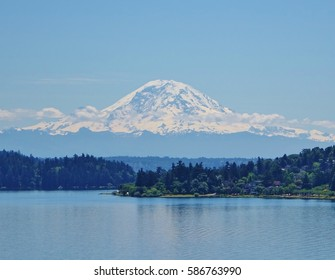 The mountain is out. 14,410 foot Mount Rainier rises above Lake Washington in Seattle which is 90 miles away from the mountain, a Pacific Northwest icon.
