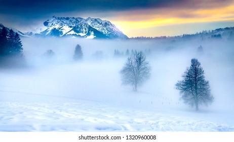 mountain outshines the fog on snowy land travel winter wonderland bavaria