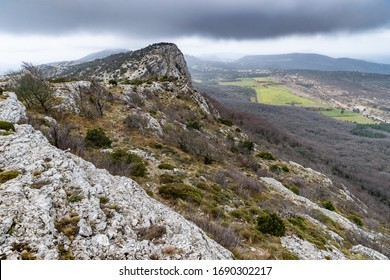 The mountain over grotto of Mary Magdalene at cloudy weather, clouds over a valley, a dry grass - Shutterstock ID 1690302217