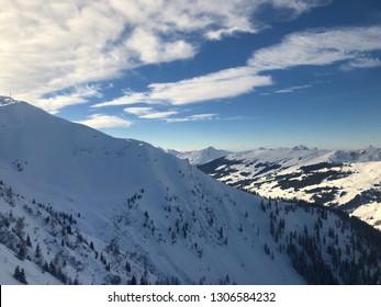 Mountain panorama of the Austrian ski resort of Saalbach-Hinterglemm , Austria with great cloudscape