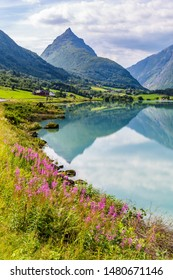 Mountain panorama with mountain Eggenipa reflecting in a lake in Gloppen along highway E39 in Sogn og Fjorden county in Norway