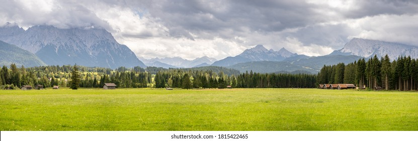 mountain panorama of the karwendel mountains with clouds in bavaria, germany