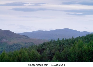 Mountain panorama landscape of the Scottish Highlands with the Erchless Forest in the foreground and the peaks of the Glen Affric range in the background