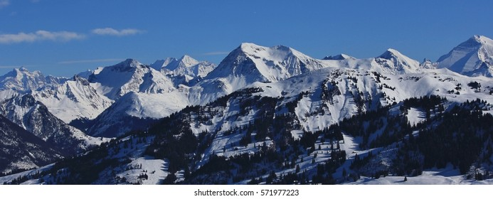 Mountain panorama seen from the Rellerli ski area. Snow covered mountains in the Bernese Oberland, Switzerland.