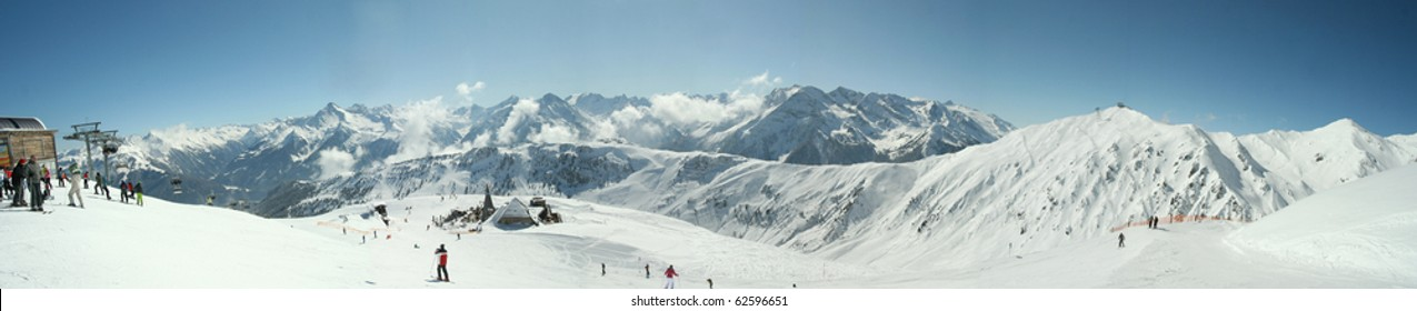 Mountain panorama.Alps.Skiers and slopes in area Zillertal