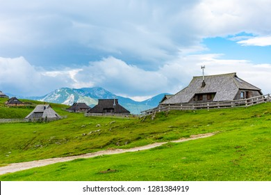 Mountain pastures on Velika Planina (Big Plateau) near city Kamnik in Slovenia alps. Mountain cottage hut or house on idyllic hill with eco farming. Great travel target for family hiking.
