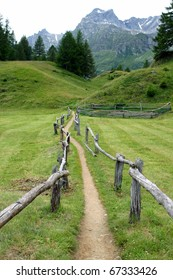 Mountain path and long wooden fence