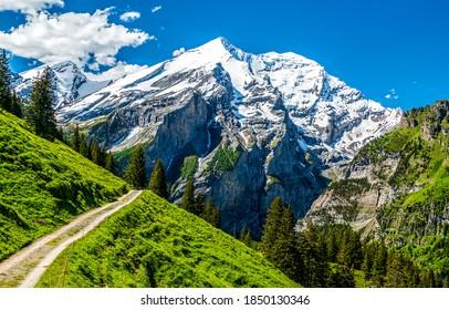 Mountain path to mountain peak snow. Mountain peak snow landscape. Mountain landscape. Mountains