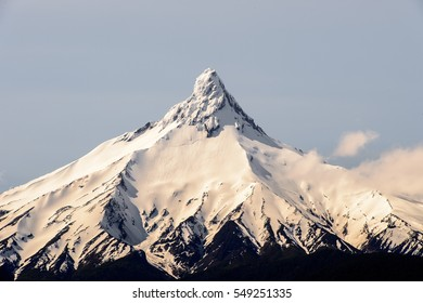 Mountain peak covered with snow in the Vicente Perez Rosales National Park, Sector Puella, Chile, South America