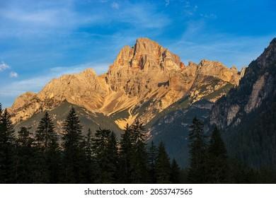 Mountain Peak of the Dolomites at Sunrise. Croda Rossa D'Ampezzo or Hohe Gaisl, Dolomites, UNESCO world heritage site, Trentino-Alto Adige and Veneto, Bolzano and Belluno province, Italy, Europe.