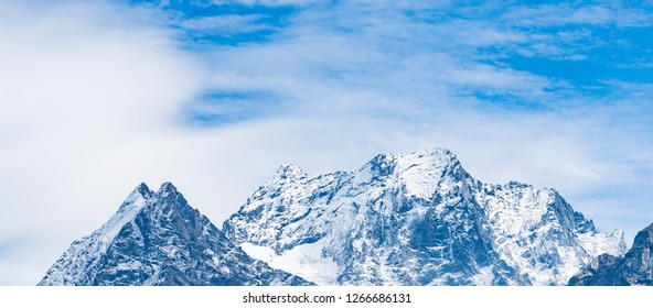 Mountain peak Dombay. National Park, Russia, Karachay-Cherkessia.. Banner, panoramic view.