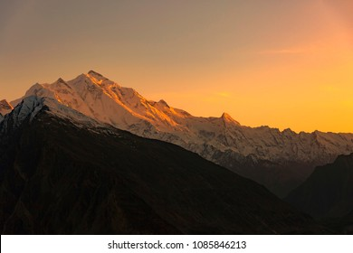Mountain peak with during sunset on top, Rakaposhi mountain peaks in Pakistan.