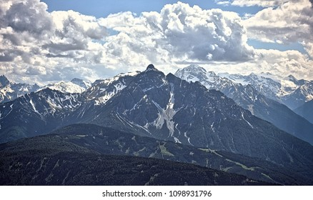 Mountain peak with forrested sides in front