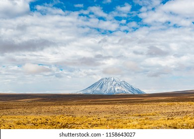 The mountain peak of the Misti Volcano towering above the altiplano in the region of Arequipa, Peru.