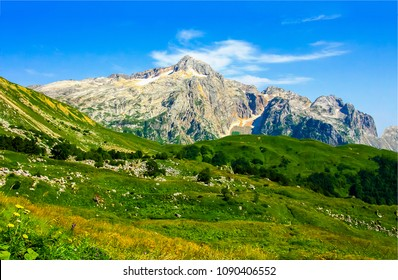 Mountain peak range landscape. Green mountain range view. Mountain peak blue sky white clouds panorama