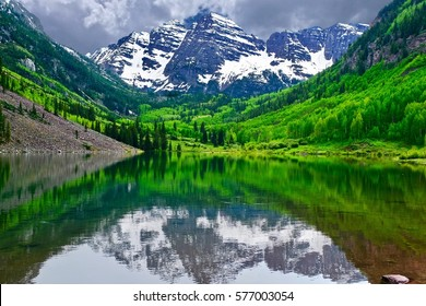 Mountain peak reflection in calm lake. Maroon Bells near Aspen, Snowmass Village,  Colorado State, USA.