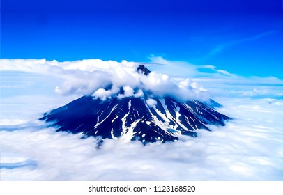 Mountain peak snow in clouds sky panorama. Cloudy mountain peak snow landscape. Mountain peak snow cloudscape view